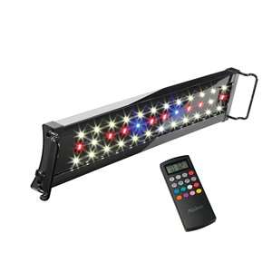 Remote control next to LED fish tank light fixture